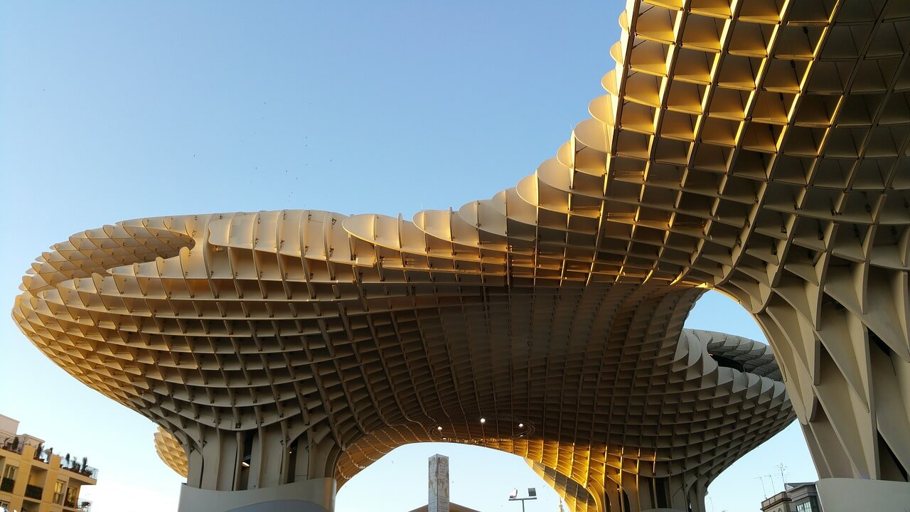 An image looking up at the Metropol Parasol on a clear day